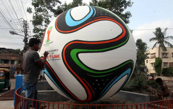 Meanwhile another artist, Rabindra Pally, gives finishing touches to a giant replica of the official FIFA World Cup ball in South Kolkata. (Source: IE Photo by Partha Paul)