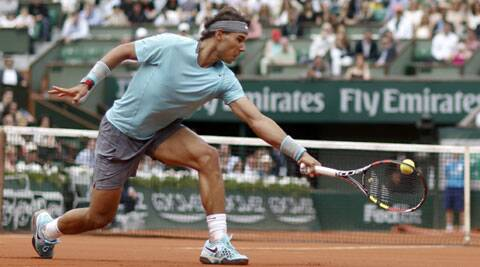 Rafael Nadal returns a backhand to Dusan Lajovic of Serbia during their men's singles match at the French Open in Paris on Monday. (Source: Reuters)