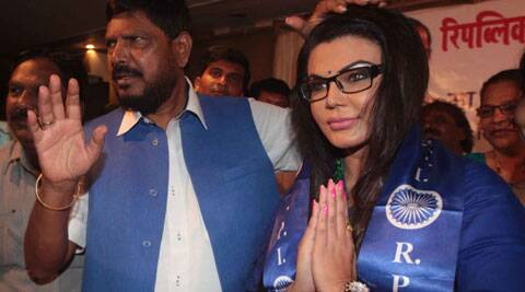 RPI  leader and Rajya Sabha MP Ramdas Athavale welcome  Bollywood actress-turned-politician Rakhi Sawant as she join the RPI party during the press conference   at MIG  club ,Bandra on Saturday. (Source: Express photo by Kevin DSouza)