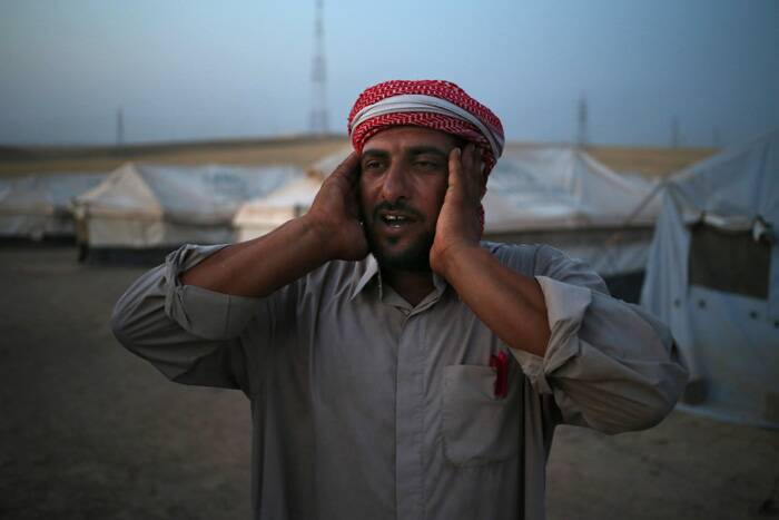 An Iraqi displaced man calls for prayer. (Source: AP)