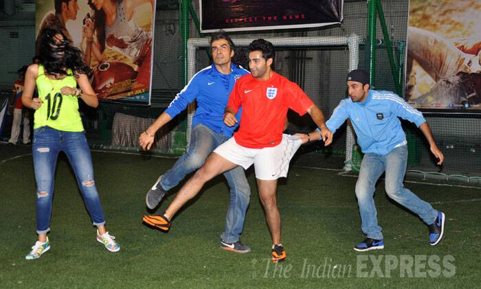 All's fair in love and game - Ranbir pulls Armaan by his shorts to get hold of the ball. (Source: Varinder Chawla)
