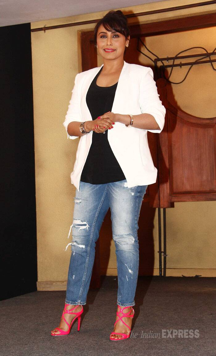 Newly married Rani, who was last seen in public at an event with mom-in-law decked up in red suit with chura, was stylish in a white blazer with a black vest, ripped denims. She finished off her look with neon coloured Jimmy Choo sandals.Rani had  tied the knot with Aditya Chopra in April this year. (Source: Varinder Chawla)