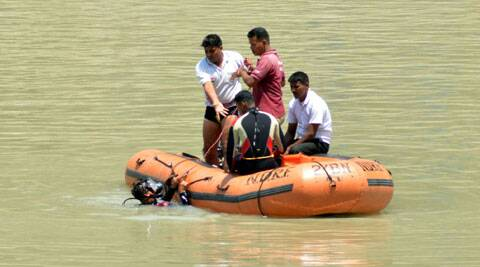 Rescue operations is carried out in Beas River in Mandi, Himachal Pradesh on Friday. (Source: IE)