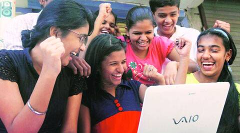 Students react after checking their results online. (Source: Express photo by Deepak Joshi)