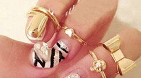 Get stylish with midi rings | Source: IANS