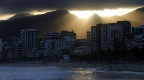 A man wades in the sea at Ipanema Beach during sunset in Rio de Janeiro June 4, 2014.  Source: Reuters