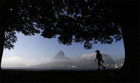 A woman is silhouetted against the backdrop of the sugar loaf mountain in Rio de Janeiro June 5, 2014.  Source: Reuters