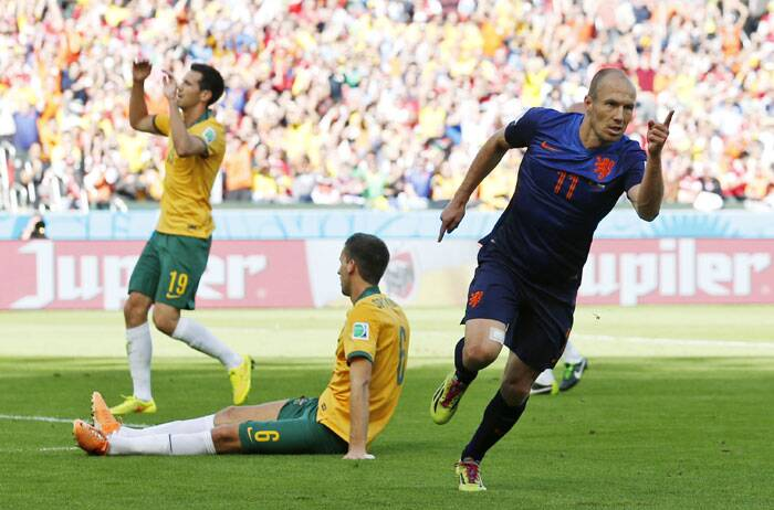 It's all about speed: Arjen Robben breaks into a sprint after scoring his side's second goal against Australia. (Source: AP)