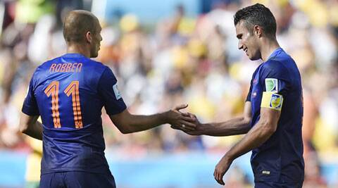 Netherlands' Arjen Robben congratulates Robin van Persie  after he scored his side's second goal (Source: AP)