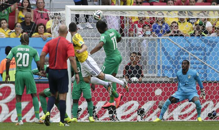 Colombia and Ivory Coast clashed in their Group C match at the Estadio Nacional in Brasilia.  Colombia's James Rodriguez (C) scored his side's opening goal during the 64th minute of the match. (Source: AP)