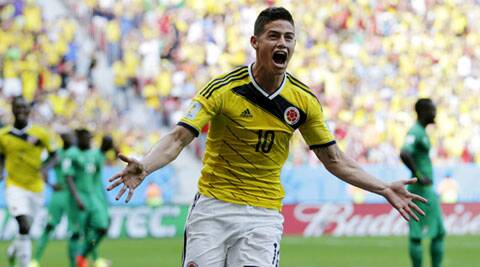 James Rodriguez scored Colombia's first goal with a thunderous header. (Source: AP)