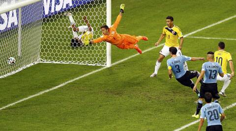 Uruguay's goalkeeper Fernando Muslera (2nd L) fails to save a goal scored by Colombia's James Rodriguez (R), his second goal, during their 2014 World Cup round of 16 game at the Maracana stadium (Source: Reuters)