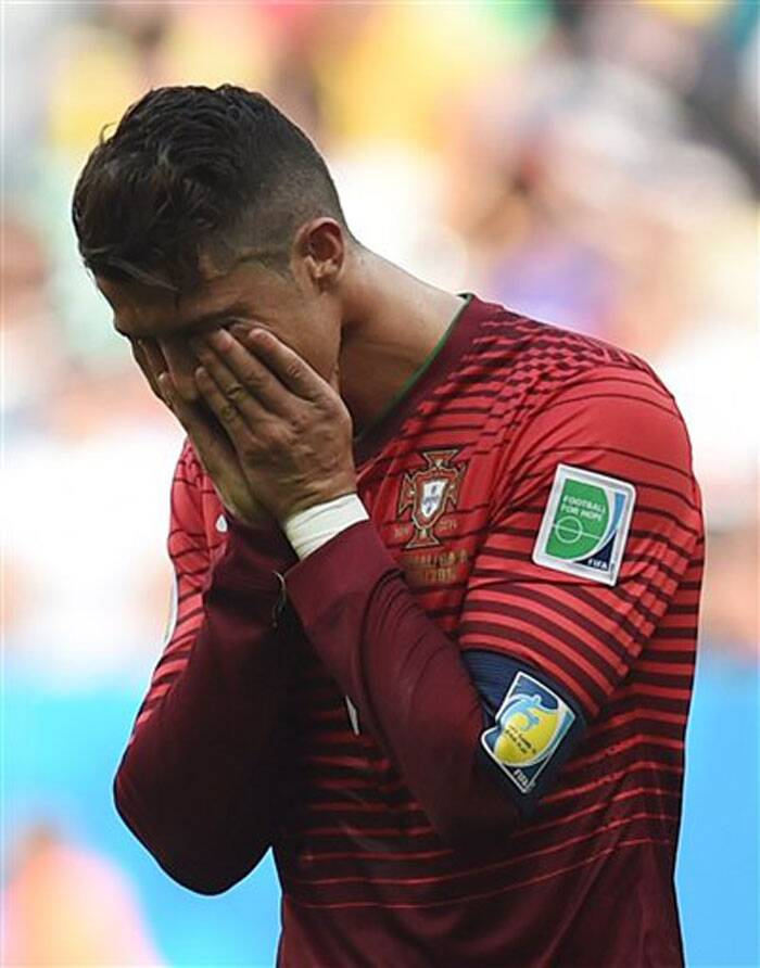 Cristiano Ronaldo's first goal of the World Cup earned Portugal a 2-1 win over Ghana but couldn't prevent his team being eliminated from the tournament along with the Africans on Thursday. (Source: AP)