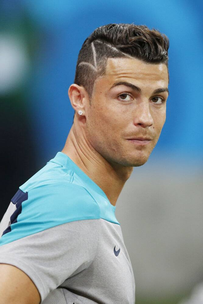 The Portuguese star, one of the richest sportsperson in the world, has not experimented with his hair for the first time. His Manchester United days saw him with long curly hair before he moved to Madrid and changed to side-parting and even spikes. (Source: AP)