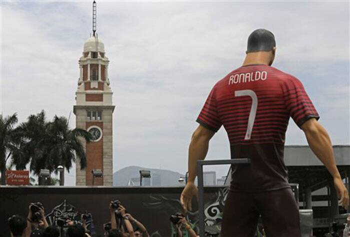 Portugal's Cristiano Ronaldo is a big star not only in his country but also in Hong Kong. Pictured here is a giant size figure of Ronaldo displayed outside a shopping mall in Hong Kong to promote the World Cup in Brazil.  (Source: AP)