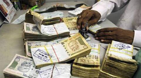 Rupee hovered in a range of 60.08 and 60.20 per dollar during the morning deals.