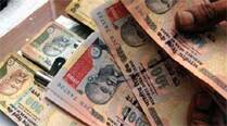 Indian rupee trims initial loss, still down 18 paise to 61.26
