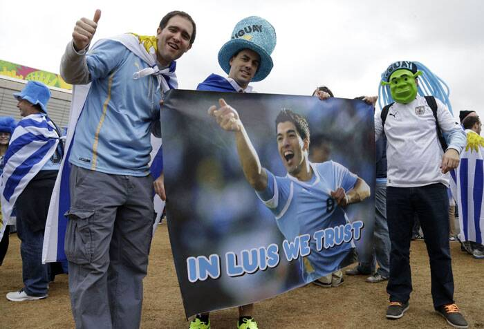 He's Back: Luis Suarez's return has given Uruguay fans new found zeal after they were disappointed by the team's surprise 1-3 loss to Costa Rica. (Source: AP)