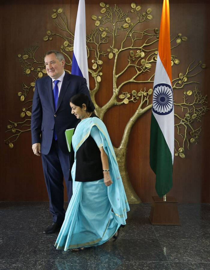 Issues relating to economic cooperation, energy security and the deal for the third and fourth reactors of Kudankulam power plant figured in the talks. <br /> Russian Deputy Prime Minister Dmitry Rogozin, left and Sushma Swaraj, arrive for their meeting in New Delhi. (Source: PTI)