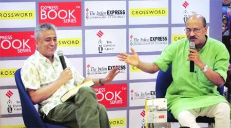 Rajdeep Sardesai with Shekhar Gupta at the book reading; guests wait their turn to get their books signed.