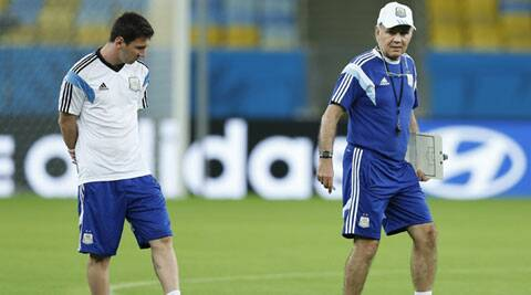 Argentina's Lionel Messi (L) and head coach Alejandro Sabella (R) enter the Maracana Stadium last Saturday. (Source: AP)