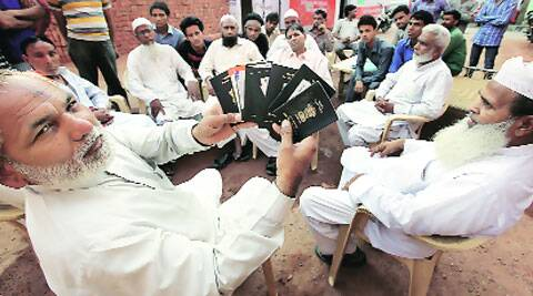 A group of Shias in Delhi, with their passports on Tuesday. ( Source: Express photo by Ravi Kanojia )
