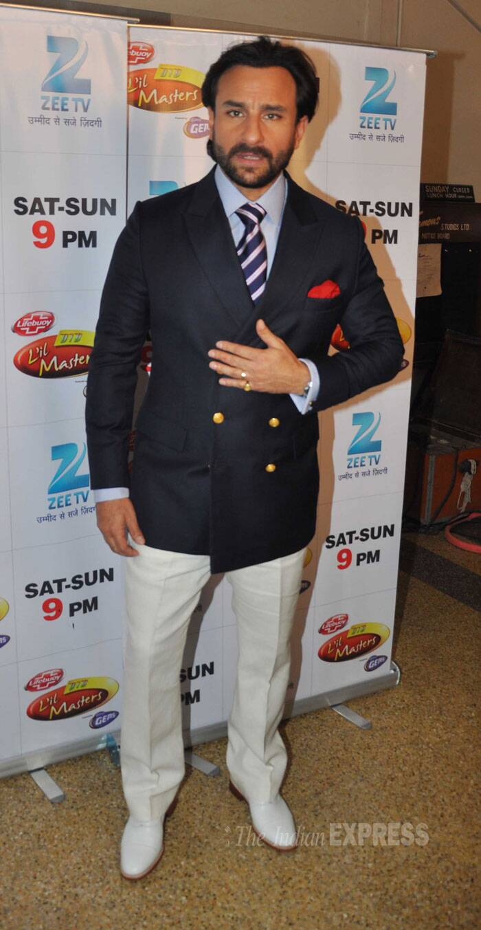Chotte Nawab Saif Ali Khan was suave in a blazer. We really like the choice of shoes - white. (Source: Varinder Chawla)