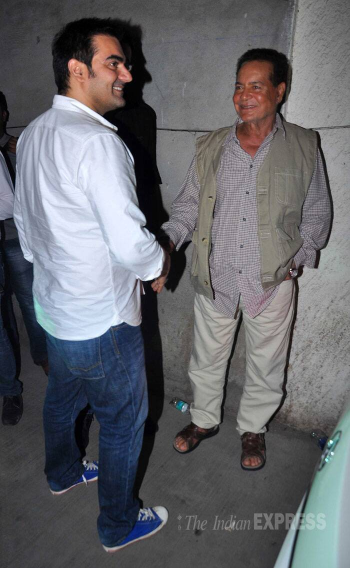 Salman Khan's family including father Salim Khan, mother Salma Khan, step mom Helen also stepped out for their weekly dose of entertainment. Writer Salim Khan is all smiles as he chats with his son Arbaaz. (Source: Varinder Chawla)