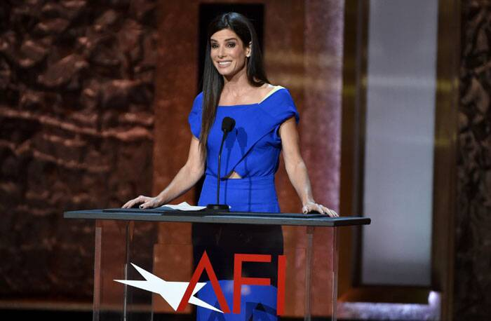Oscar winning actress Sandra Bullock was lovely in blue as she took the stage. (Source: AP)