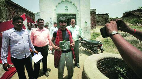 A sanitation survey being carried out in Badaun district. (Source: Express photo by Praveen Khanna)