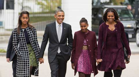 FILE - In this Oct. 27, 2013, file photo, President Barack Obama, second from left, with first lady Michelle Obama, right, and their daughters Malia, left, and Sasha, walk from the White House in Washington to attend a church service. Obama is encouraging more employers to adopt family-friendly policies by hosting a daylong summit, even though the U.S. government doesn't always set the best example. The United States is the only industrialized nation that doesn't mandate paid leave for mothers of newborns, although Obama says he'd like to see that change. (Source: AP)