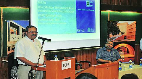 Minister for Industry and Power Saurabh Patel addresses IIMA students on the campus on Saturday.(Source: Express photos)