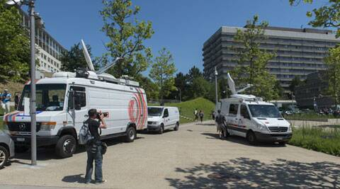 A TV truck outside the University Hospital in Lausanne where Michael Schumacher will undergo rehab (Source: AP)