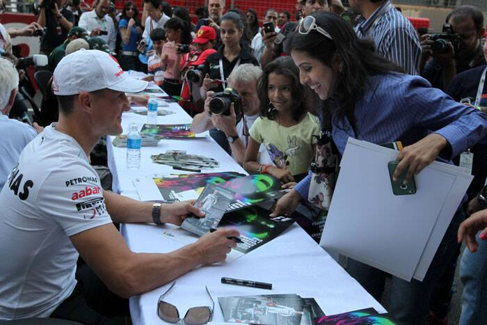 Michael Schumacher has a great fan following all over the world and even Indian fans adore the superstar. Fans take autograph of the legend in New Delhi during the Indian Grand Prix 2012. This was Schumacher's last race in India and he retired after the Brazilian Grand Prix the same year. (Source: Express Photo by Ravi Kanojia)