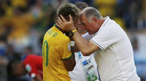 Brazil's Neymar (L) is congratulated by coach Luiz Felipe Scolari after they won their penalty shootout against Chile (Source: Reuters)