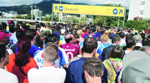 Fans making their way to the Maracana for the Belgium vs Russia game. ( Source: Express photo by: Aditya Iyer )