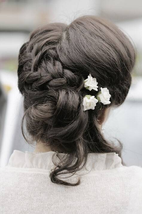 A rustic country wedding calls for a romantic and feminine hair updo. Source: Thinkstock Images