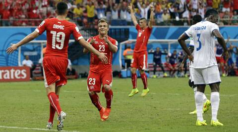 Switzerland's Xherdan Shaqiri, second left, celebrates with teammate Josip Drmic (19) after scoring his side's third goal during the group E contest (Source: AP)