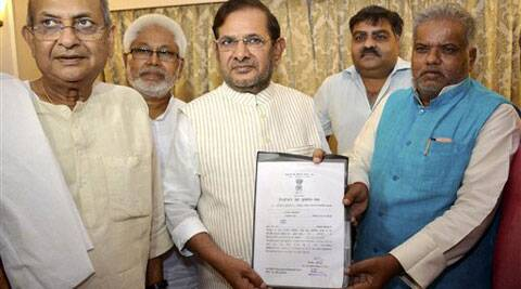 JD(U) national president Sharad Yadav showing the winning certificate after being elected as Rajya Sabha member, in Patna on Thursday. (Source: PTI)