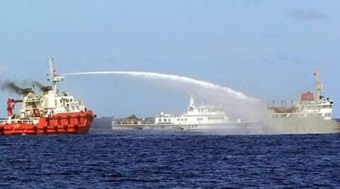 A Chinese ship, left, shoots water cannon at a Vietnamese vessel, right, trying to stop Beijing from setting up an oil rig in the South China sea. ( Source: AP )