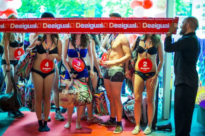 People dressed in underwear wait for the go-ahead to pick free clothes during a promotional event starting the summer sale at an outlet of the Desigual clothing retailer in Berlin. (Source: Reuters)