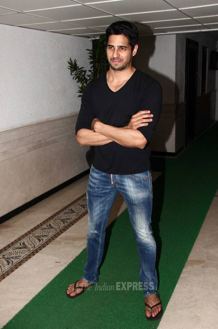 Sidharth was dashing in  denims and black t-shirt as he posed smugly for the photogs. (Source: Varinder Chawla)