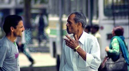 A man smokes at ISBT in Sector 17, Chandigarh, despite a ban on public smoking. (Express)