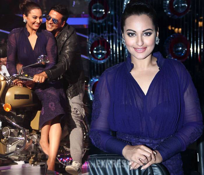 The pair, who have graced the silver screen together before, looked lovely as they posed for pictures on a motorbike. Sonakshi opted for a dark blue dress and heels. (Source: Varinder Chawla)