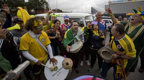 Fans gather in numbers outside the Itaquerao, where Brazil and Crotia will kick off the 2014 FIFA World Cup (Source: AP)
