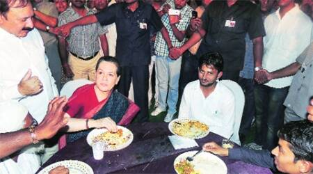 Congress president Sonia Gandhi having dinner with party workers in Rae Bareli on Friday. (Express Photo:Pramod Singh)