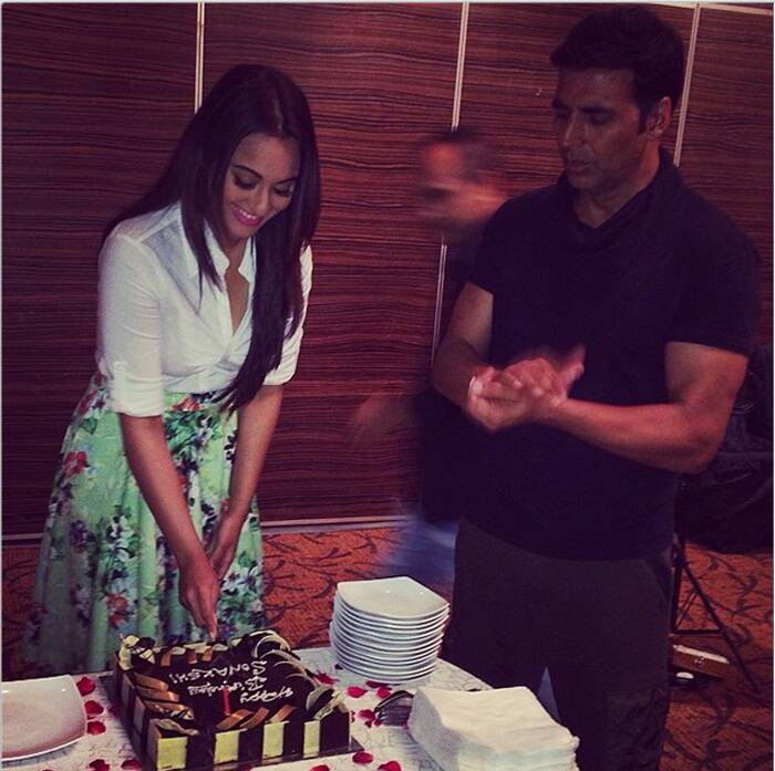"Bollywood actress Sonakshi Sinha has taken the subtitle of her film 'Holiday' a little too seriously. The actress, who earlier partied with her friends from the film fraternity at a posh Mumbai club, spent the rest of the day shooting for the film. The 27-year-old actress shared a picture of her birthday celebrations saying, ""Holiday - Sona is never off duty. Not even on her birthday!! Cutting my 12th cake with @akshaykumar. The blur behind is Vipul Shah our producer who dint give me an off :p"" (Source: Instagram)"