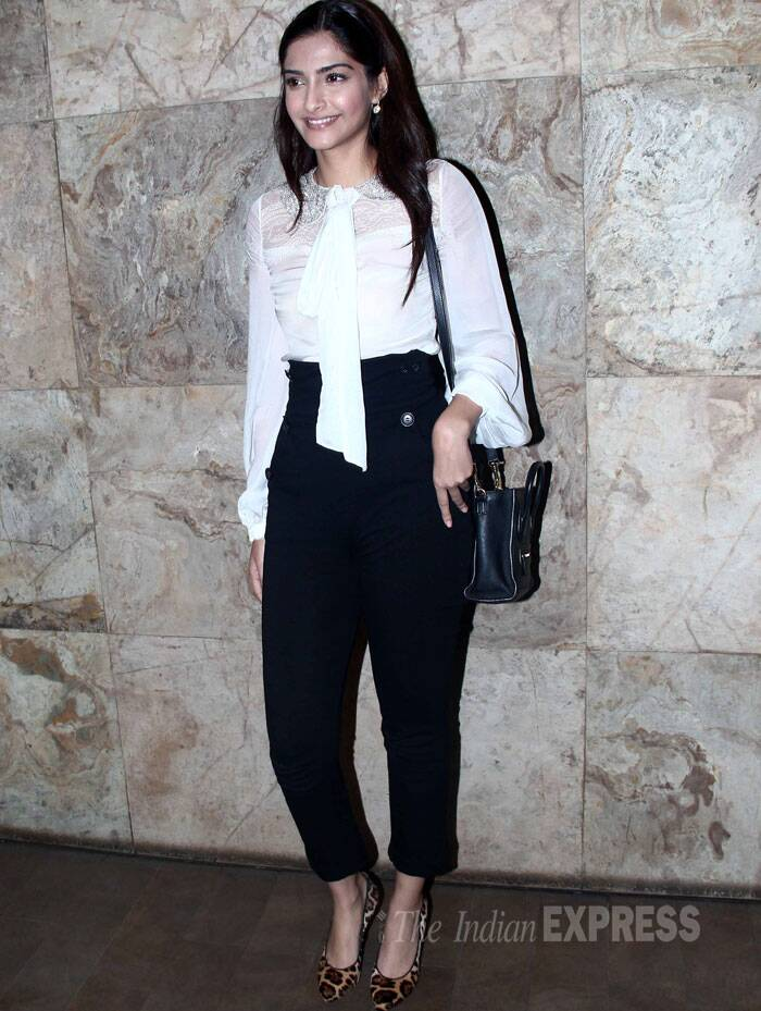 Sonam Kapoor was chic in a white blouse with high-waist black-cropped pants and leopard print pumps. (Source: Varinder Chawla)