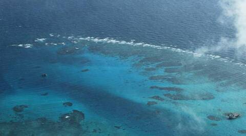 This March 13, 2012 file photo taken by a surveillance plane and released by the Philippine Department of Foreign Affairs, shows the Johnson Reef, locally called Mabini Reef, called Mabini by the Philippines and Chigua by China, at the Spratly Islands at South China Sea. (AP)