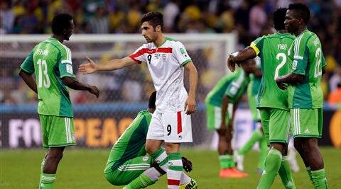 Iran's Alireza Jahanbakhsh, centre, reaches out to shake hands with Nigeria's Juwon Oshaniwa after the group F World Cup soccer match between Iran and Nigeria. ( Source: AP Photo )